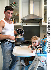father with the son on the kitchen