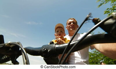 Father With Toddler Riding The Bike