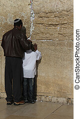 Prayer of the father and young son at the Wailing Wall (Western wall), Jerusalem, Israel