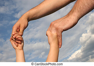 father\'s and son\'s hands pair