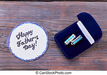 Father's Day card and cufflinks.