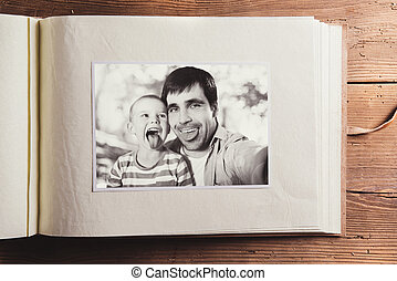 Fathers day composition - photo album with a black and white...