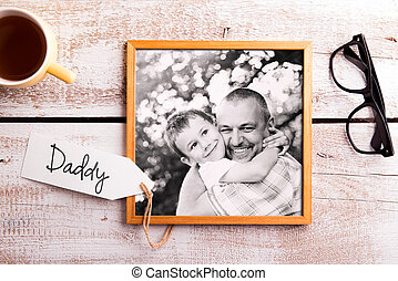 Fathers day composition. Picture of father holding his son