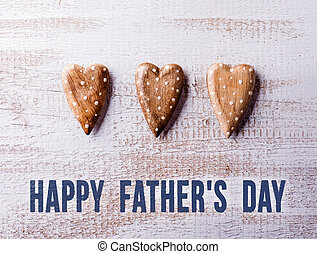 Fathers day composition. Wooden hearts. Studio shot