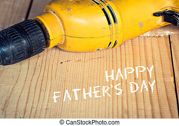 Fathers day concept, Electric well used power drill, close up with copy space