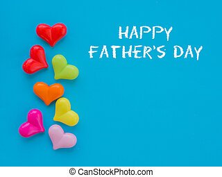 HAPPY FATHER'S DAY text with colorful heart and gift on blue background