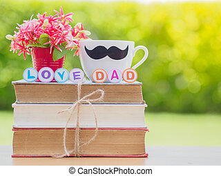 Father's day concept. LOVE DAD alphabet on stack of books