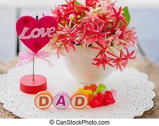 LOVE DAD alphabet with colorful heart and flower on background