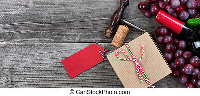 Fathers day gift box with a bottle of red wine and grapes for the holiday season
