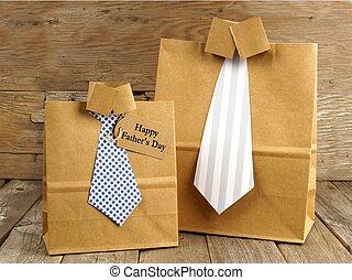 Fathers Day handmade shirt and tie gift bags with greeting card on a wood background