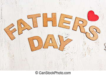 Fathers Day with wooden letters on an old white background