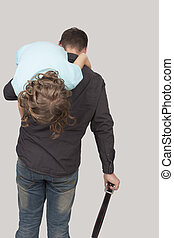 father's punishment - father holding her teenage daughter...