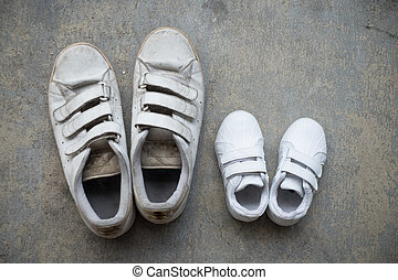 Father's sneakers and kids sneakers side by side