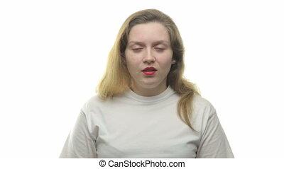Fatty yawning blond woman, video on white background