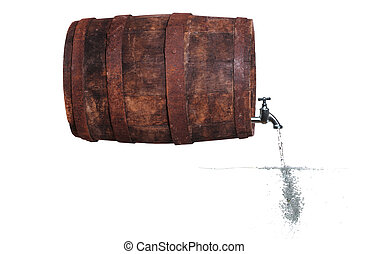faucet in wooden barrel with water and bubbles