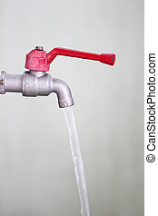 faucet with water flowing. - faucet with water flowing for...