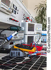 faulty solar regulator on solar panel checking using an oscilloscopes in laboratory