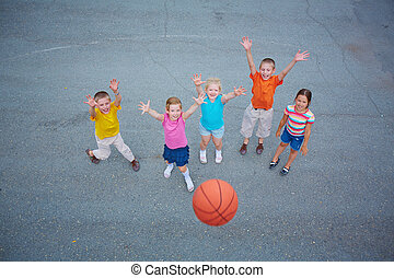 Favorite game - Cute friends playing basketball on sports ...