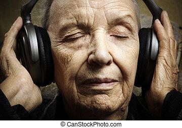 favorite music - senior closeup with modern big headphones,...