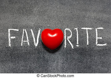 favorite word handwritten on blackboard with heart symbol instead of O