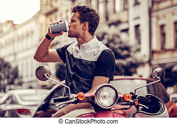 Handsome good looking man drinking his coffee