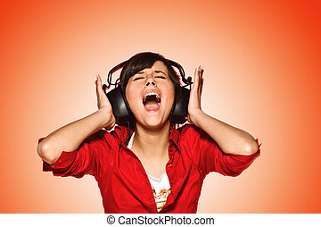 Young woman in headphones singing her favourite song