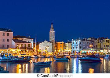 Fazana, Istria, Croatia promenade and church by night