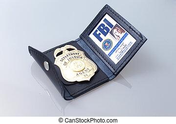 FBI badge and ID of a female agent.