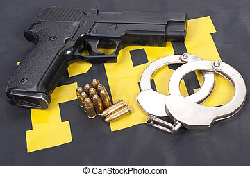 fbi concept with gun ammo and handcuffs