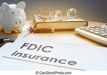 FDIC insurance on a side of piggy bank.