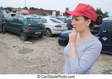 feamle worker on junkyard