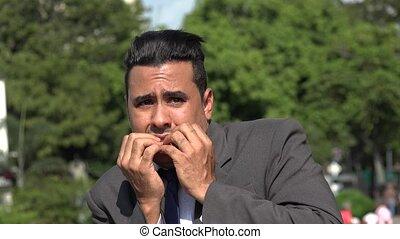 Fearful Hispanic Business Man