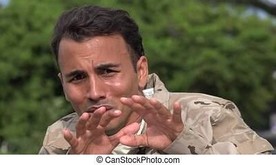 Fearful Hispanic Male Soldier
