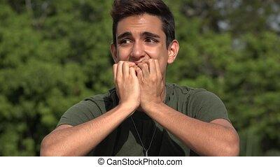 Fearful Male Hispanic Teenage Soldier Recruit