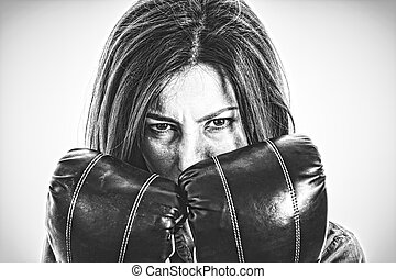 fearless and furious modern business woman with boxing gloves is