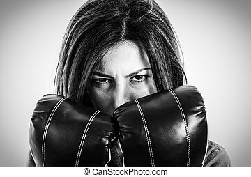 fearless and furious modern business woman with boxing gloves
