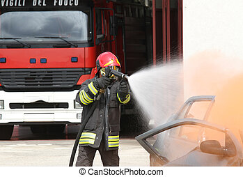 fireman extinguishes the fire after car accident 1