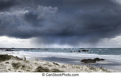 Fearsome giant storm cloud approaching coastline in...