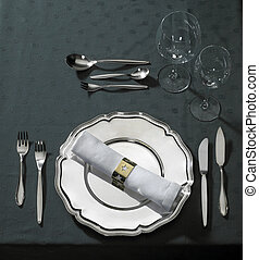 feastful place setting on green tablecloth - classy place...
