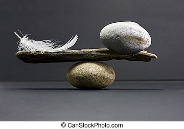 feather and stone balance - a feather and a stone equally...