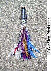 feather skirted lure for big game angler fish