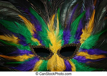 Feathered Mask - A feathered Mardi Gras mask in yellow,...