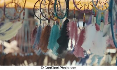 Feathers decor hanging at market stall. - Feathers decor...