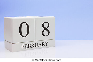 February 08st. Day 08 of month, daily calendar on white table with reflection, with light blue background. Winter time, empty space for text