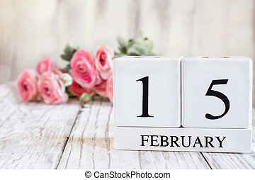 February 15th Calendar Blocks with Pink Ranunculus in Background