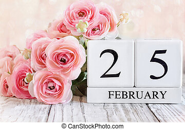February 25 Calendar Blocks with Pink Ranunculus in Background