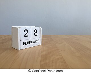 February 28th. Cube calendar for february 28 on wooden surface with empty space For text. Leap year, intercalary day
