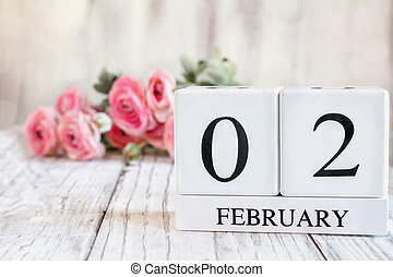 February 2nd Calendar Blocks with Pink Ranunculus in Background