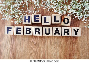 february alphabet letters on wooden background