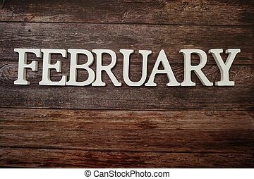 February alphabet letters with space copy on wooden background
